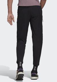 adidas Performance - TERREX CLIMB THE CITY TROUSERS - Trousers - black - 1