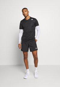 adidas Performance - OWN THE RUN RESPONSE RUNNING  - Sports shorts - black - 1
