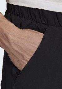 adidas Performance - ADIDAS Z.N.E. JOGGERS - Tracksuit bottoms - black - 5