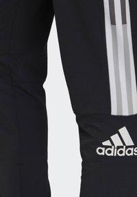 adidas Performance - ADIDAS Z.N.E. JOGGERS - Tracksuit bottoms - black - 4
