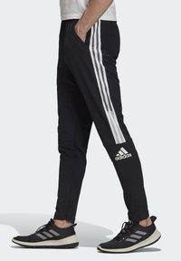 adidas Performance - ADIDAS Z.N.E. JOGGERS - Tracksuit bottoms - black - 2