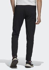 adidas Performance - ADIDAS Z.N.E. JOGGERS - Tracksuit bottoms - black - 1