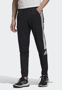 adidas Performance - ADIDAS Z.N.E. JOGGERS - Tracksuit bottoms - black - 0