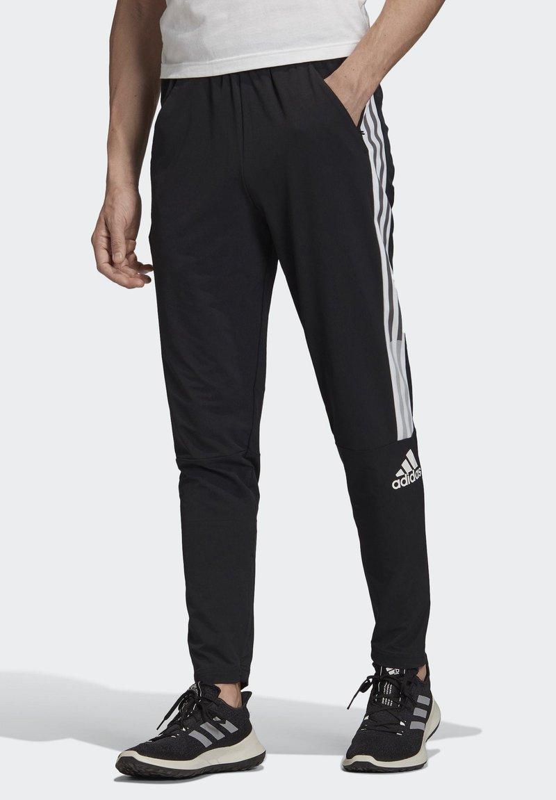 adidas Performance - ADIDAS Z.N.E. JOGGERS - Tracksuit bottoms - black