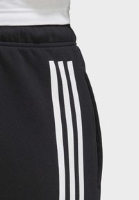 adidas Performance - MUST HAVES FLEECE JOGGERS - Spodnie treningowe - black - 5