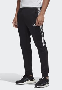 adidas Performance - MUST HAVES FLEECE JOGGERS - Spodnie treningowe - black - 0