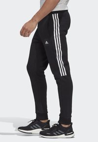 adidas Performance - MUST HAVES FLEECE JOGGERS - Spodnie treningowe - black - 2