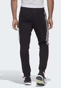 adidas Performance - MUST HAVES FLEECE JOGGERS - Spodnie treningowe - black - 1