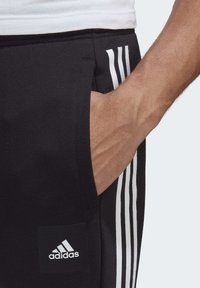 adidas Performance - MUST HAVES FLEECE JOGGERS - Spodnie treningowe - black - 3