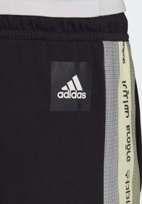 adidas Performance - MUST HAVES GRAPHIC JOGGERS - Tracksuit bottoms - black - 4
