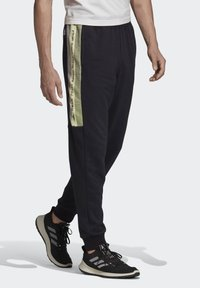 adidas Performance - MUST HAVES GRAPHIC JOGGERS - Tracksuit bottoms - black - 2