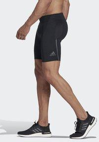 adidas Performance - SATURDAY SHORT TIGHTS - Sports shorts - black - 2