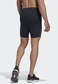adidas Performance - SATURDAY SHORT TIGHTS - Sports shorts - black - 1