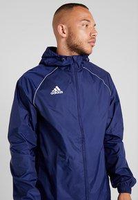 adidas Performance - CORE 18 RAIN JACKET - Hardshelljacka - dark blue/white - 4