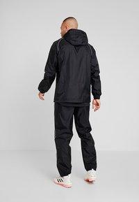 adidas Performance - CORE ELEVEN FOOTBALL JACKET - Kurtka hardshell - black/white - 2