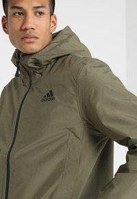 adidas Performance - BSC CLIMAPROOF RAIN - Waterproof jacket - raw khaki - 4