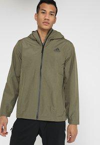 adidas Performance - BSC CLIMAPROOF RAIN - Waterproof jacket - raw khaki - 0