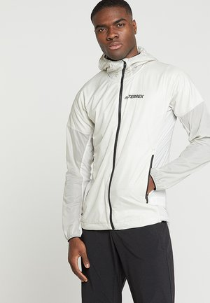 TERREX AGRAVIC ALPHA HOODED SHIELD - Windbreaker - raw white