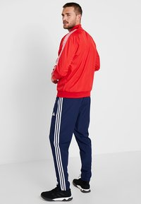 adidas Performance - FCB ANTHEM - Veste de survêtement - true red/white - 2