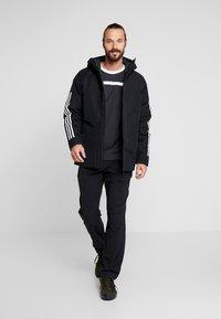 adidas Performance - XPLORIC 3-STRIPES WINTER JACKET - Winterjas - black - 1