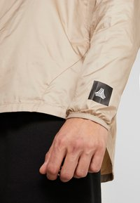 adidas Performance - TAN PISTE  - Windbreaker - olive - 6