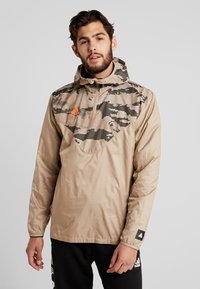 adidas Performance - TAN PISTE  - Windbreaker - olive - 0