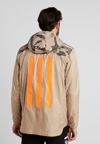 adidas Performance - TAN PISTE  - Windbreaker - olive - 2