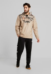 adidas Performance - TAN PISTE  - Windbreaker - olive - 1