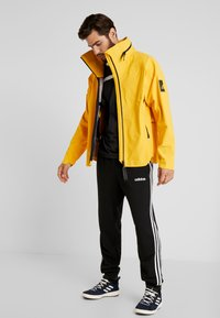 adidas Performance - MYSHELTER RAIN.RDY - Giacca hard shell - active gold - 1