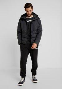 adidas Performance - CLIMAWARM DOWN JACKET - Winter jacket - carbon - 1
