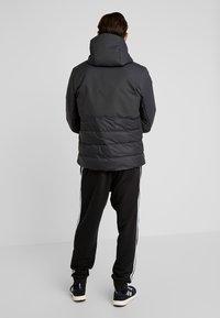 adidas Performance - CLIMAWARM DOWN JACKET - Winter jacket - carbon - 2