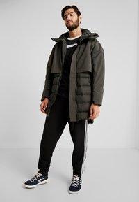 adidas Performance - MYSHELTER CLIMAHEAT PARKA DOWN JACKET - Vinterjacka - legear - 1