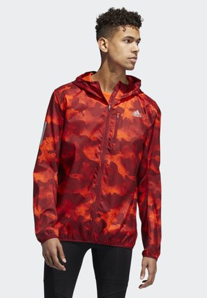 OWN THE RUN CAMOUFLAGE JACKET - Giacca softshell - orange