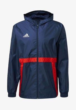 TAN - Training jacket - blue