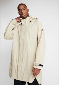adidas Performance - URBAN RAIN.RDY  - Waterproof jacket - sand - 0