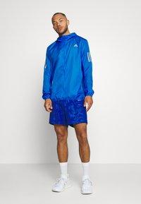 adidas Performance - OWN THE RUN  - Chaqueta de deporte - blue - 1
