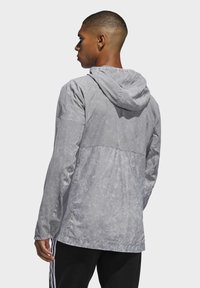 adidas Performance - OWN THE RUN HD WINDBREAKER - Veste coupe-vent - gray - 1