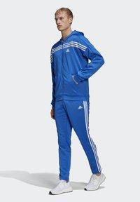adidas Performance - MTS TRACKSUIT - Sweatjacke - blue - 1