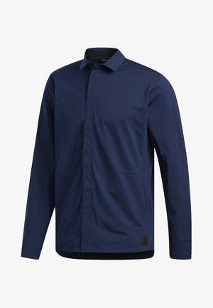 ADICROSS WARP KNIT JACKET - Soft shell jacket - blue