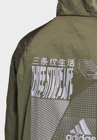 adidas Performance - ANORAK WIND.RDY WINDBREAKER - Veste coupe-vent - green - 5
