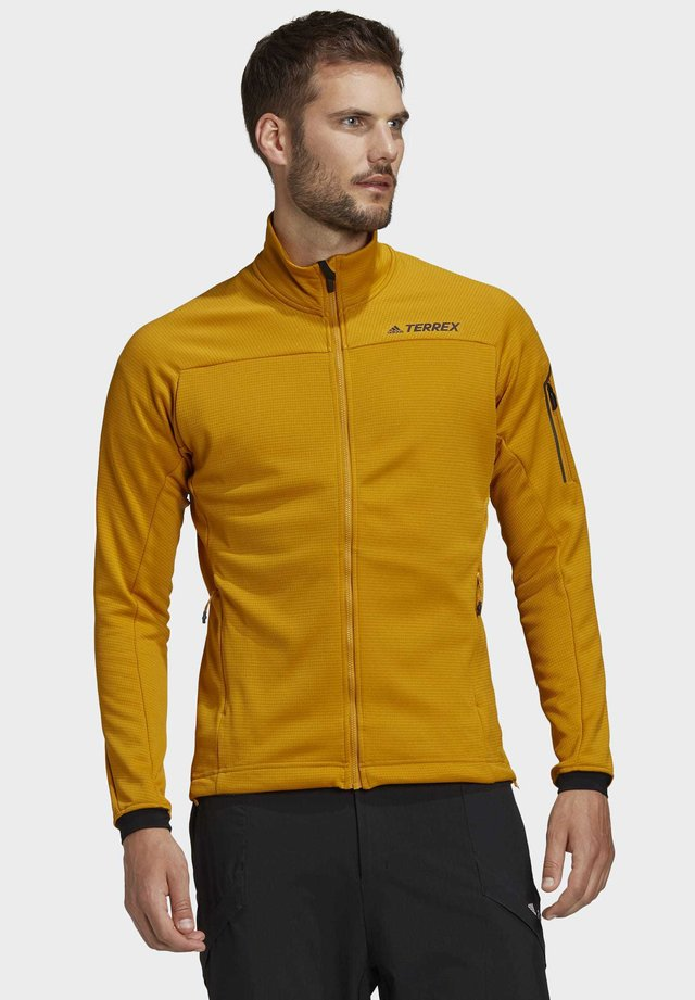 STOCKHORN FLEECE JACKET - Verryttelytakki - gold