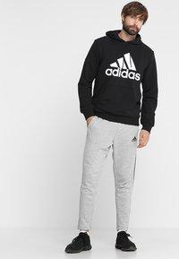 adidas Performance - MUST HAVES SPORT REGULAR FIT HOODIE - Hættetrøjer - black/white - 1