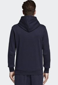adidas Performance - MUST HAVES BADGE OF SPORT HOODIE - Luvtröja - blue