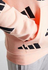 adidas Performance - ATHLETICS PACK SPORT RELAXED FIT HOODIE - Hoodie - glow pink/black - 4