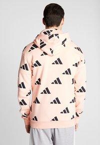 adidas Performance - ATHLETICS PACK SPORT RELAXED FIT HOODIE - Hoodie - glow pink/black - 2