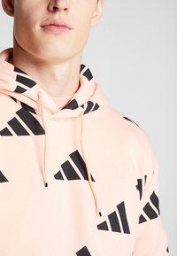 adidas Performance - ATHLETICS PACK SPORT RELAXED FIT HOODIE - Hoodie - glow pink/black - 6