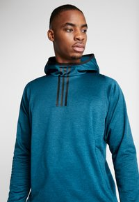adidas Performance - WARM HOODIE - Mikina s kapucí - tech mint - 3