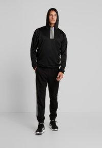 adidas Performance - WARM HOODIE - Hoodie - black - 1