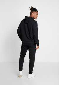 adidas Performance - CAMO LIN  - Bluza z kapturem - black/white - 2