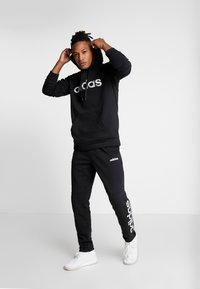 adidas Performance - CAMO LIN  - Bluza z kapturem - black/white - 1